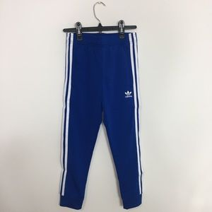 Girls blue adidas track pants with white stripes
